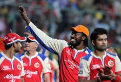 Royal Challengers Bangalore player Chris Gayle with his teammates during the victory lap after winning the match during match 70 of the Pepsi Indian Premier League between The Royal Challengers Bangalore and The Chennai Super Kings held at the M. Chinnaswamy Stadium, Bengaluru on the 18th May 2013