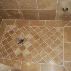 Travertine Floor With A Larger Tile Up The Walls.