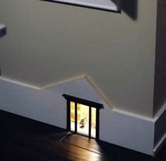 A Tiny Baseboard Mouse House | 41 Coolest Night Lights