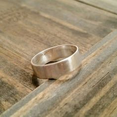 Sterling Silver Wedding Band, Rustic Wedding Band, Satin finish by SilverBearJewelryCo on Etsy https://www.etsy.com/listing/489808162/sterling-silver-wedding-band-rustic