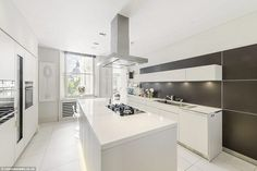 The gleaming white modern kitchen at the property which is based in Ennismore Gardens, London where Gardner, who famously starred in The Killers, The Barefoot Contessa, 55 Days at Peking and The Night of the Iguana, lived until her death in 1990