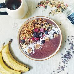 A big Berry, Banana and Spinach Smoothie Bowl - Topped with wild figs and activated Buckinis, Cacao Nibs and Homemade Granola