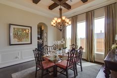 Formal dining room with wood beams on the ceiling - Firethorne/Houston Real Estate http://www.coventryhomes.com/houston/firethorne/communities