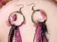 textile vintage crystals wire wrapped boho earrings with flowers and feathers. $30.00, via Etsy.