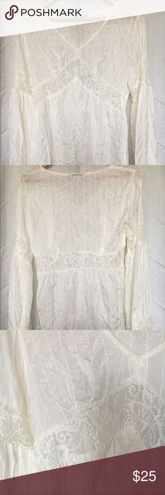 """Cream Silk Boho Top Flared Empire Waist This lovely top was never worn. 100% Silk. Boho style with bell sleeves and lace details on both the bodice and arms... mint condition like new. Hand washed once, just needs to be ironed. Tag says Small but runs bigger and would fit up to a Medium / C-cup, but not big enough for a D-cup. Bust 19"""". Sleeves 24"""". Length 23.5"""". Make me an offer : ) Ice Tops Blouses"""