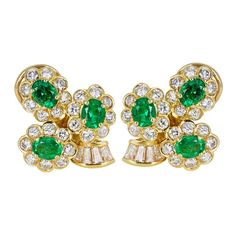 Emerald and Diamond Floral Cluster Earrings | From a unique collection of vintage clip-on earrings at http://www.1stdibs.com/jewelry/earrings/clip-on-earrings/