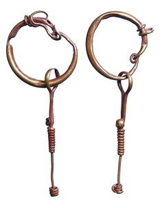 Roman gold earrings, 1st-3rd century A.D. Circular design with long and slender dangling extension which is spiraled in center, 5 cm high. Private collection