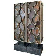 Pair of Wave Front Cabinets by Paul Evans, 1971   From a unique collection of antique and modern cabinets at http://www.1stdibs.com/furniture/storage-case-pieces/cabinets/