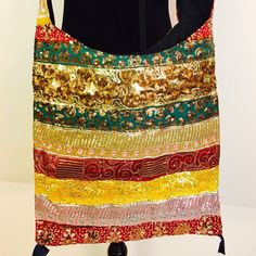 Handmade handcrafted embroidered with sequence work cotton cross body shoulder handbag.