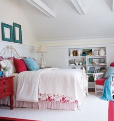 Painted vintage pieces, a wrought iron headboard, beadboard panelled walls and a floral bedding set deliver country cottage decorating style. Love the shade of red here...