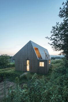 Panelled almost entirely with a bright selection of wood, the Shear House by…