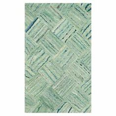 "Add a lovely touch to your living room or den with this hand-tufted cotton rug, showcasing a distressed cross-weave motif in green.  Product: RugConstruction Material: 100% CottonColor: GreenFeatures:  Hand-tuftedMade in IndiaPile Height: 0.5"" Note: Please be aware that actual colors may vary from those shown on your screen. Accent rugs may also not show the entire pattern that the corresponding area rugs have.Cleaning and Care: Professional cleaning recommended"