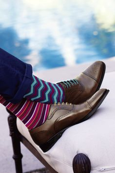 Tip: With whimsical socks and bright laces, you can turn a favorite pair of shoes into a new pair. (Paul Smith, $30)