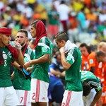 Carlos Salcido of Mexico (L) take on fluids during a cooling break