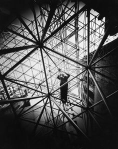 Buckminster Fuller 1959 | Bucky Fuller Forever: Salute to an American Visionary | LIFE.com  Bucky standing on octet truss designed and built by TC Howard of Synergetics, Inc for MoMA in 1959.