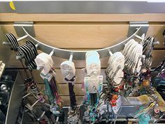 This Curved Hook Array on Slatwall is a clever and good looking curved multi-hook for small items or jewelry merchandising display. Gift Shop Displays, Store Displays, Retail Displays, Jewellery Display, Jewelry Shop, Circle Hook, Retail Shelving, Slat Wall, Stationery Shop