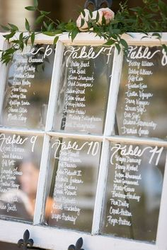 Whimsical seating chart idea - vintage window draped in greenery and pink peonies {Tracy Autem & Lightly Photography}