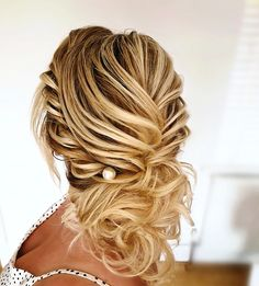 A textured, twisted curled low hair up #bridalhair #hairupideas #bridetobe #hairupinspo #hairup #essexweddingsupplier