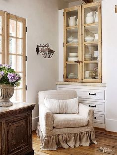 French kitchens invite friends and family to gather. A chair covered in an informal linen slipcover provides comfortable overflow seating.