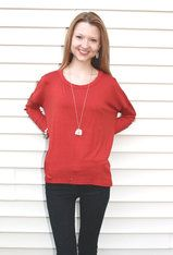 Rust Top with Lace Doily Elbows Simple top, in a perfect warm color with feminine lace detail. Use this top as a basis of a great outfit. Pair it with a vest to show off those elbows! White Barn Boutique