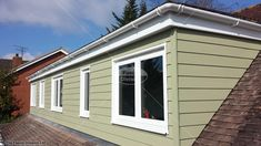 UPVC windows, guttering, fascias and soffits with HardiePlank® cladding Wiltshire Upvc Windows, Dormer Windows, Windows And Doors, Cedral Weatherboard, House Cladding, Lodges, New Homes, Outdoor Structures, House Design