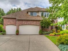 This immaculate home featuring custom detail and exquisite design throughout backs to a THPRD green space. It boasts custom architectural details including French doors lots of windows high ceilings hardwood floors and granite.
