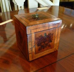 Absolutely stunning! A late 18th century George III period Cube Tea Caddy veneered with choice panels of burr yew to the front; sides and the lid, crossbanded with mahogany and inlaid with chequer stringing. The interior is utterly original and is complete with its original yew-wood interior lid, and remains of the lead lining. From Quiet Street Antiques
