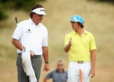 Rickie Fowler Photos Photos - Phil Mickelson of the United States and Rickie Fowler of the United States in discussion ahead of the 142nd Open Championship at Muirfield on July 16, 2013 in Gullane, Scotland. - 142nd Open Championship: Previews