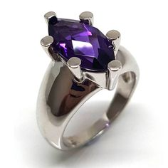 A gemstone ring for us bigger girls. A large marquise shape purple color Amethyst gem set in a chunky 925 silver band is best suited to larger fingers. Amethyst Gemstone, Purple Amethyst, Gemstone Rings, 925 Silver, Sterling Silver Rings, Solitaire Ring, Semi Precious Gemstones, Jewelry Branding, Cocktail Rings