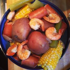 Slow low country boil. Crock pot recipe with shrimp, sausage, corn, potatoes cooking all day in veggies and seasoning. Delish.