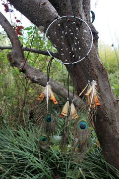 """6"""" Diameter Brass Ring Dream Catcher, with Sinew, Labradorite Stone Beads. Black Leather Cord, Brass Spacer Beads, Peacock and Turkey Feathers Accent this Lovely Dream Catcher. Total Length Approximat"""