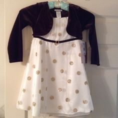 Girls dress Brand new with tags. Cream color dress with gold glitter dots. Comes with a brown shrug attached to the dress Other
