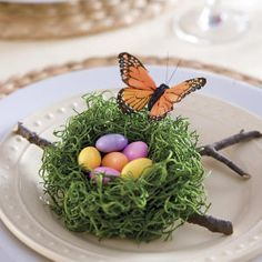 THE EVERYDAY HOME: create small place settings with craft store moss, formed into small nests and added to twigs, with colorful candies nestled inside.  www.everydayhomeblog.com