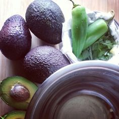 vegan guacamole - avocados, jalapenos from my garden, and a variety of herbs from my garden including cilantro, basil, rosemary, sage, thyme and oregano.
