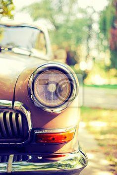 Close-up fotografie retro automobilových světlometů na obrazech myloview. Nejlepší kvality plakáty, fototapety, myloview sbírky, nálepky, obrazy. Chcete si vyzdobit Váš domov? Pouze s myloview!