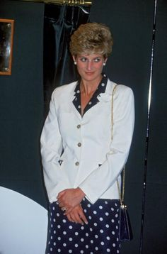 Princess Diana, wearing a navy polka dot dress and white jacket, during a visit to the Bruges House nursing home in Cardiff, 30th June 1993.