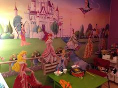 Fastest way to decorate a girls room is add a picture wall paper. Princess theme is in.