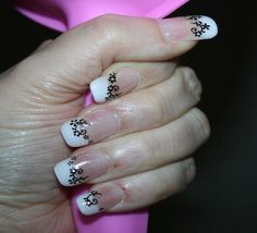 Went for a French manicure design but with a twist, which was achieved with black and gem stickers.