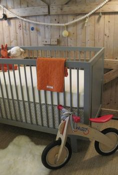Love the gray crib and the simple bedding...don't worry though, not going to install barn doors behind the crib.