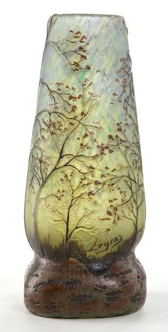 LEGRAS GLASS LANDSCAPE VASE . Blue and green glass with ochre overlay, etched and enameled in landscape motif, circa 1900.