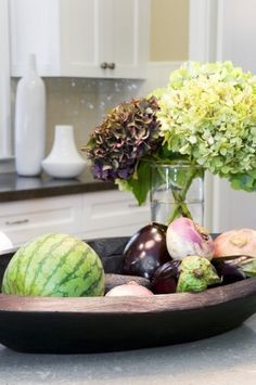 Some fruits and vegetables are strikingly beautiful on display alongside cut flowers. Just be sure to choose hardy fruits and veggies, and plan to eat them within a week.