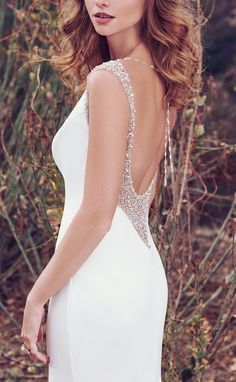 Simultaneously opulent and understated Evangelina by #MaggieSottero... #Maggiebride #vintagebrides #sexyback #plungingback #crepegown