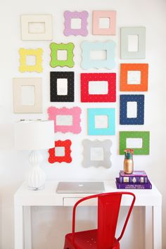 Gallery wall of colorful frames - http://www.pencilshavingsstudio.com/2013/07/product-styling-photoshoots/