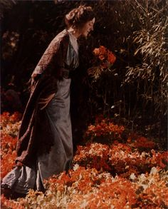 Carolyn Even Gledhill with Nasturiums, 1920 - autochrome by Edwin Gledhill, Canadian-born photographer, 1888 - 1976, pioneered the use of the autochrome process for portraiture.