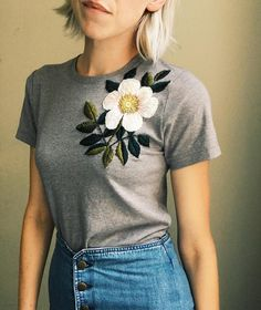 Grey T, white flower🌿 - tessa_perlow Embroidery On Clothes, Shirt Embroidery, Embroidered Clothes, Hand Embroidery Stitches, Embroidery Fashion, Silk Ribbon Embroidery, Flower Embroidery, Embroidery Designs, Diy Vetement