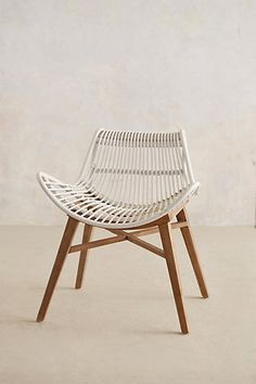 scrolled rattan chair. anthropologie