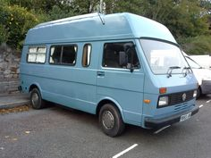 VW LT camper - with a high top and elevating roof.