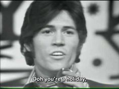 Bee Gees - Holiday (1967) [High Quality Stereo Sound, Subtitled] - The song is haunting, even eerie, having been composed primarily in a minor key with a strong orchestral presence. Barry and Robin Gibb,  who also wrote the song, share lead vocals. There was also a promo video made for this song. The song remained a concert favorite for over 30 years, and Maurice often provided the audience with comedic antics by attempting many failed attempts to join Barry  Robin while singing this song.