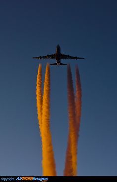 Boeing 747-4KZF/SCD    Flashing her headlights as she passes us overhead, leaving a beautiful orange contrail behind while the sun sets slowly.