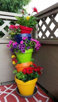 Topsy turvy flower planter   Rebar,  Terra cotta pots, acrylic paint, krylon clear coat, and pretty flowers! Paint several coats of acrylic paint and wait 24 hours before putting the spray too coat on or else your pot will turn colors (I learned the hard way)